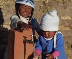 Bolivian girls at tap